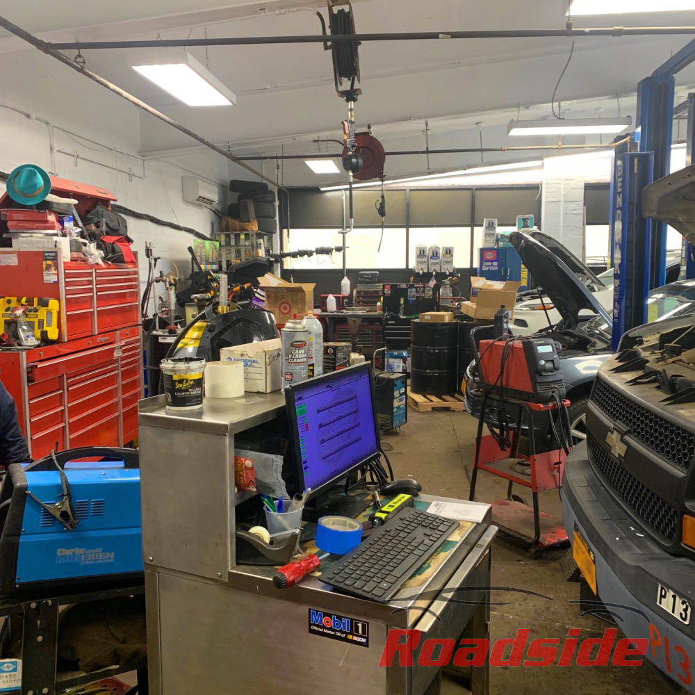 Busy garage at Roadside Auto. Diagnostics machines and tool boxes.