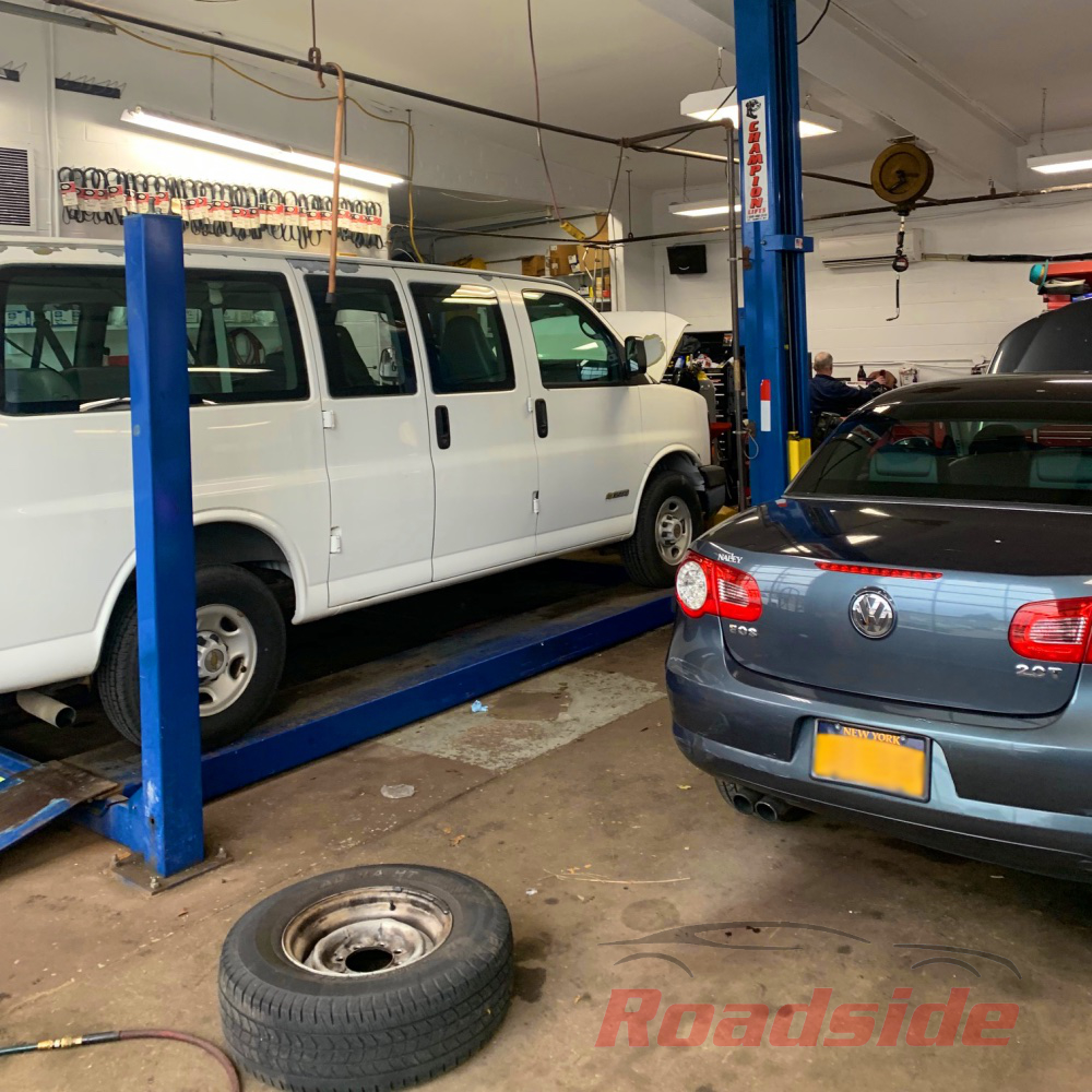 A van and VW sedan being serviced at Roadside Auto